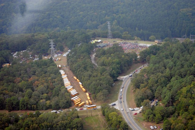 Numerous school buses from North Central Arkansas school districts brought about 2,900 students to the 50th Anniversary Ceremony of the dedication of Greers Ferry Dam.