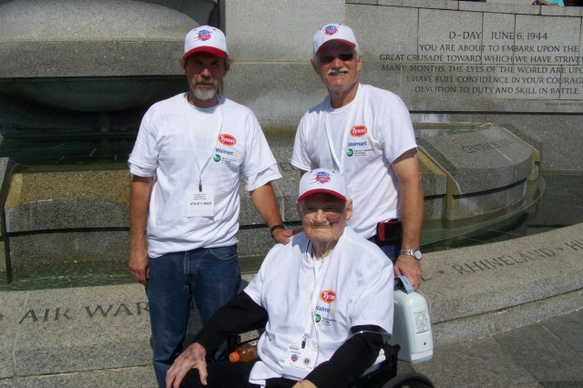 Bill Gray (left), Charles Gray (center) and Tommy Gray (right) at the World War II Memorial.