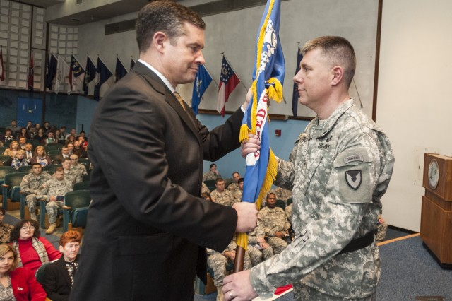 Brig. Gen. William E. Cole receives the colors from Dale Ormond, director, U.S. Army Research, Development and Engineering Command, during the Dec. 5 Assumption of Command ceremony at Natick Soldier Systems Center. Cole became Natick's senior commander.