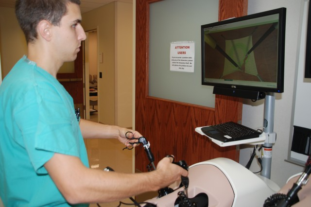 Army Capt. Michael Clemens, general surgery resident, practices on the laboratory virtual simulator in the simulation center at San Antonio Military Medical Center. The center offers simulation labs made to replicate the operating room, intensive care unit, ward, and trauma rooms.