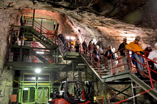 Americans are among scores of hikers as they exit the elevator 500 meters below the surface to enter the Merkers mine.