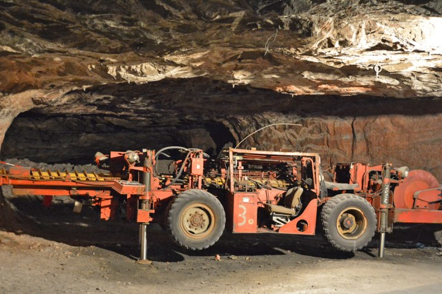 One of the machines used to carve out tunnels and minerals within the walls of the mine sits along the underground hiking trail.