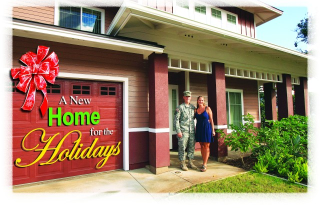 """Maj. Michael (left) and Kari Post stand on the porch of their new home in the new Hibiscus Neighborhood, here. """"Our new home is beautiful, well worth the wait!"""" said the couple."""