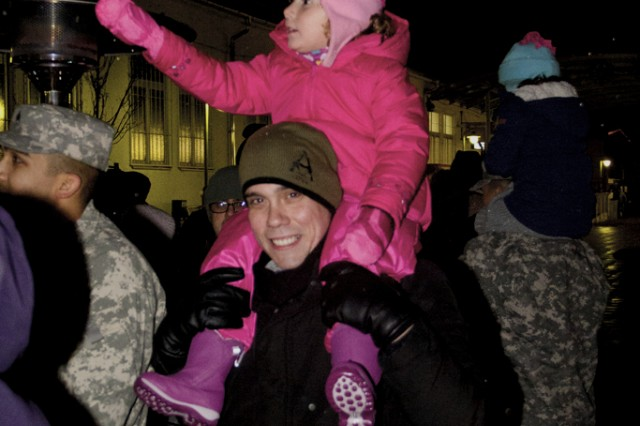 A child is excited during the festivities at the Storck Barracks Christmas tree lighting Dec. 6.