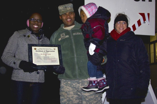 The Bright Family accept their award of Military Family of the Year at the Storck Barracks tree-lighting ceremony Dec. 6.