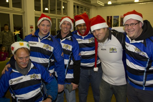 Members of the Illesheim Black 'N Blue Rugby team are in the festive spirit and pose for a group photo after the tree-lighting ceremony at Storck Barracks Dec. 6.