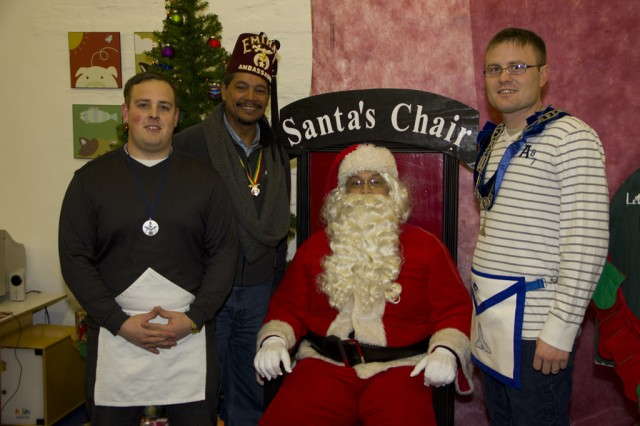Everyone wants their picture take with Santa, even members of Lodge 963.