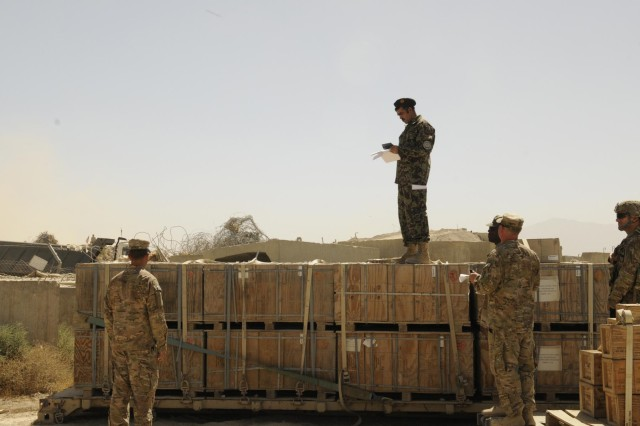 Afghan Maj. Raheem Shama, commander of the Afghan National Army Ammunition Depot (22 Bunkers), stands on top of palletized bundles small arms ammunition as he inventories each pallet at Bagram Air Field, Parwan province, Afghanistan on Aug. 26, 2013. The transfer of ammunition from Coalition partners to the ANA is in response to a shortage of small arms ammunition in the Southern regions of Afghanistan. www.facebook.com/lifeliner (U.S. Army photo by Sgt. Sinthia Rosario, Task Force Lifeliner Public Affairs)