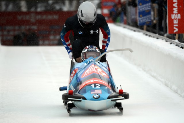 Bobsled driver Sgt. Nick Cunningham of the U.S. Army World Class Athlete Program and WCAP teammate Sgt. Dallas Robinson slide to second place in the two-man bobsled event, Dec. 6, 2013, at the International Bobsled & Skeleton Federation's 2013 World Cup stop at Utah Olympic Park in Park City, Utah.
