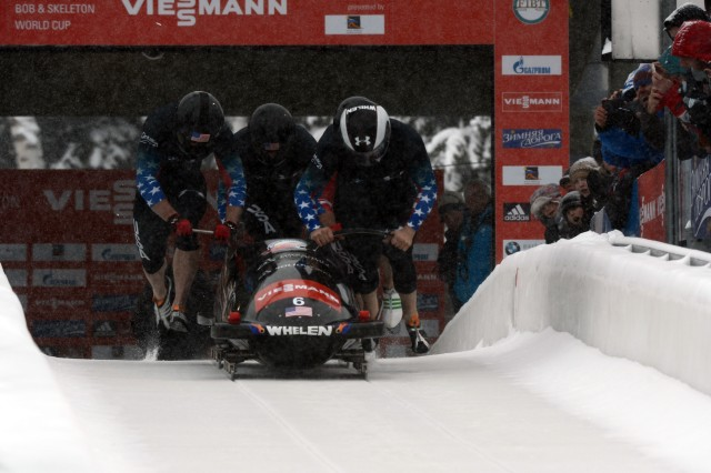 Former U.S. Army World Class Athlete Program bobsled driver Steven Holcomb (right) teams with Curtis Tomasevicz, Steven Langton and WCAP brakeman Capt. Christopher Fogt to win the four-man bobsled event at the International Bobsled & Skeleton Federation's 2013 World Cup stop, Dec. 7, 2013, at Utah Olympic Park in Park City, Utah. Holcomb, the reigning Olympic four-man champion driver who spent seven years in the U.S. Army World Class Athlete Program, is 4-0 this World Cup season with two-man and four-man victories at Calgary, Canada, and Park City.