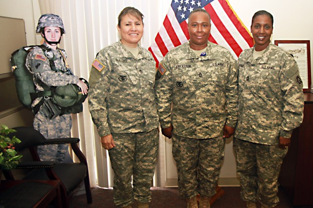 "FORT SAM HOUSTON, Texas "" Master Sgt. Glorena Russell (left), Reserve Component career counselor; Sgt. 1st Class Beatrice Robertson, career counselor for U.S. Army North (Fifth Army) and Master Sgt. Zinita Fraiser, installation career counselor for Fort Sam Houston, prepare to go meet with Soldiers before leaving their office Dec. 4. They are three of the 17 noncommissioned officers who advise Soldiers on career progression and reenlistment options at Fort Sam Houston."