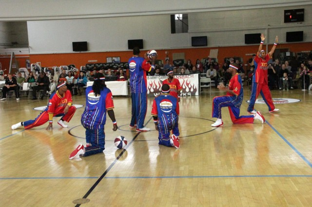 The Harlem Globetrotters warm up before their performance at USAG Ansbach's Bunch Fitness Center Dec. 8, 2013.