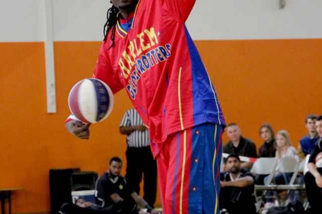 Slick spins two basketballs at once during the warm-up before the Harlem Globetrotter performance Dec. 8, 2013, at Bunch Fitness Center.