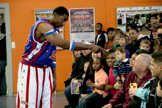 Hi-Lite has fun with the crowd during the Harlem Globetrotter performance Dec. 6, 2013, at Bunch Fitness Center at USAG Ansbach's Storck Barracks.