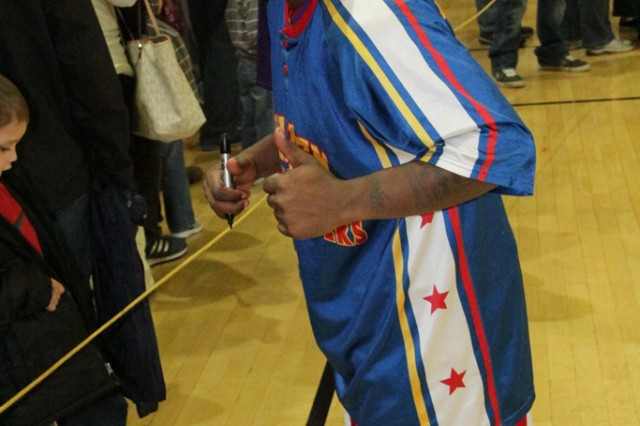 Too Tall gives the camera a thumbs up during the autograph session after the Harlem Globetrotter performance Dec. 6, 2013, at Bunch Fitness Center at USAG Ansbach's Storck Barracks.