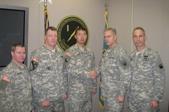 "(Left to right) Staff Sgt. Robin Brown, Sgt. 1st Class Al Williamson, Chief Warrant Officer 2 Gary Cribbs, Lt. Col. Michael Smith and Maj. Mitch Wander are pictured. Smith, the National Capital Region Information Operations Center commander, congratulates the ""Carve This"" team comprised of  Brown, Williamson, Cribbs and Wander for placing first in the 2013 Defense Cyber Crime Center Digital Forensic Challenge, Dec. 3, 2013."