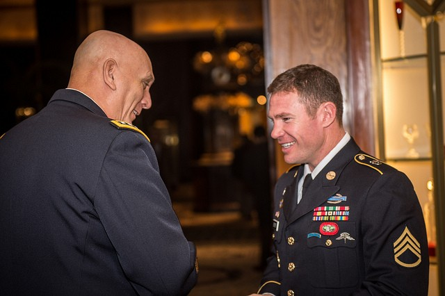 U.S. Army Chief of Staff Gen. Ray Odierno speaks with Staff Sgt. Nate Boyer before the National Football Foundation Press Conference on December 10, 2013 at the Waldorf Astoria, New York City, Ny.  (U.S. Army photo by Sgt. Mikki L. Sprenkle/Released)