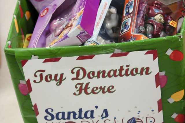 Donated toys fill a box at Fort Hood's Santa's Workshop Dec. 3. Children ages 6 months to 12 years old receive two toys, a book, and stocking stuffers; and each Family receives a board game. (Photo by Sgt. Angel Turner, 1st Cav. Div. PAO (Released)