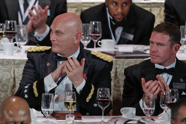 U.S. Army Chief of Staff Gen. Ray Odierno and Staff Sgt. Nate Boyer of the Texas National Guard applaud at the National Football Foundation Awards Dinner Dec. 10, 2013 at the Waldorf Astoria, New York City. (Photo by Gene Boyars)