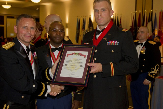Capt. Peter Bier poses for a photo after being inducted into the Honorable Order of St. Barbara, by 94th AAMDC Commander, Brig. Gen. Daniel Karbler and Command Sgt. Maj. Finis Dodson, 94th AAMDC Command Sergeant Major