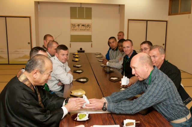 Col. William Laigaie, command chaplain, I Corps, presents Masashi Miyamoto, temple master, with a porcelain teacup as a gift, Dec. 9, 2013, in Chitose, Japan, for allowing he and his fellow chaplains to visit the temple. The chaplains visited the temple during a religious leader liaison in Hokkaido, Japan, as part of Yama Sakura 65.
