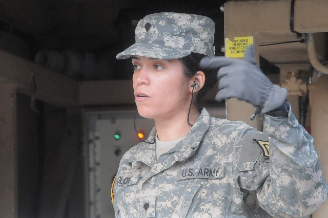 Spc. Rosie Colon, Romeo Company, 262nd QM Battalion, signals to teammates to complete actions during TWPS training at the TWPS Training Site Dec. 6