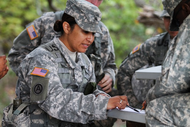Sgt. Tania Reyes, an Active Duty Soldier attending an Army Medical Department Noncommissioned Officer Academy Advanced Leader Course, plots points on a map with her classmates during a training exercise at Camp Bullis, Joint Base San Antonio, Texas. Reyes is one of 56 Soldiers who participated in the course, which the AMEDD conducted with the 80th Training Command (Total Army School System) as a precursor to the 80th's transition to the One Army School System. The OASS standardizes education for Army schools regardless of component.