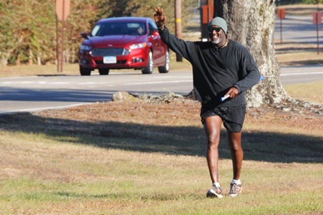 Jamie Ambler runs along Andrews Avenue Dec. 2, waving and smiling to all the cars that pass him on his morning workout.