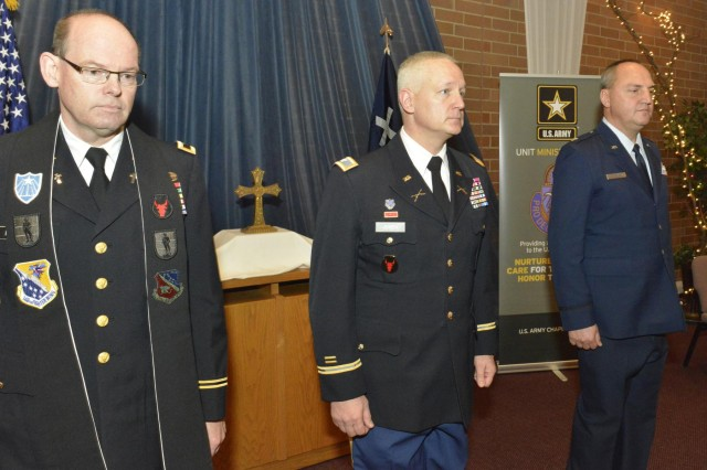 "The Minnesota National Guard Chaplain Corps became more ""purple"" today with the ""passing of the stole"" from Col. John Morris, Army chaplain, to Lt. Col. Tim Martenson, Air Force chaplain. Martenson is the Minnesota National Guard's newest state chaplain and its first Air Force state chaplain. The ceremony took place at North Heights Lutheran Church, Arden Hills, Minn., Dec. 9. The presiding officer for the changing of the stole was Col. Jon Jensen, joint chief of staff, Minnesota National Guard. (U.S. Army National Guard photo by Army Sgt. Johnny Angelo/Released)"