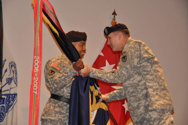 Gen. Dennis L. Via, AMC commanding general, receives the ceremonial flag from Command Sgt. Maj. Ronald T. Riling, the outgoing senior enlisted advisor during a formal ceremony at the Bob Jones Auditorium at 10 a.m. on Dec. 12. U.S. Army Photo by Cherish Washington, AMC Public Affairs.