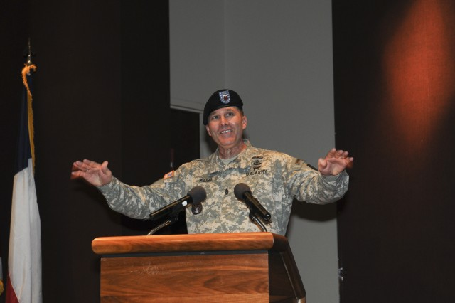 Command Sgt. Maj. Ronald T. Riling, outgoing command sergeant major, gives remarks to a crowd of friends and family during the change of responsibility ceremony at the Bob Jones Auditorium on Dec. 12. U.S. Army Photo by Doug Brewster.