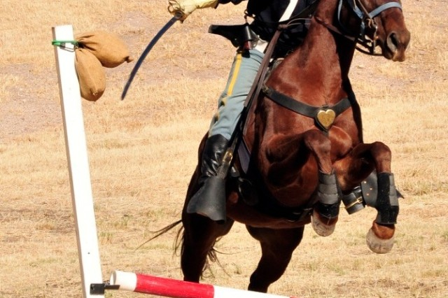 A trooper demonstrates the use of the cavalry saber on an obstacle course.