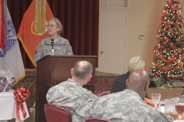Chaplain (Col.) Bonnie Koppell, command chaplain, 807th Medical Command (Deployment Support), speaks to members of the Network Enterprise Technology Command during a luncheon Tuesday, at the Thunder Mountain Activity Centre.
