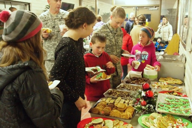 Family members and Soldiers choose from a variety of Christmas cookies in one of the Main Post Chapel hallways. The cookies, along with soup hot dogs and hot beverages were provided during the Main Post Chapel's Holiday Lighting ceremony Dec. 5.