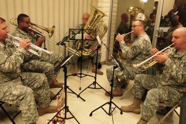 The Military Intelligence Corps Band plays holiday music inside the Main Post Chapel Activity Room. Due to cold weather and rain, the Soldiers performed both outdoors and indoors during the Main Post Chapel's Holiday Lighting ceremony on Dec. 5.