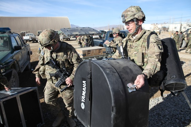 U.S. Army 1st Sgt. Daniel Shannon with Headquarters and Headquarters Battalion, 101st Airborne (Air Assault) Division Band delivers new musical equipment on Forward Operating Base Thunder, Paktiya province, Afghanistan, Dec. 14, 2013. 101st Airborne donated over forty thousand dollars worth of musical instruments and equipment to the 203rd Corps band. The new musical instruments replace the antiquated equipment the 203rd Corps used for years. (U.S. Army photo by Spc. Ryan D. Green/Released)