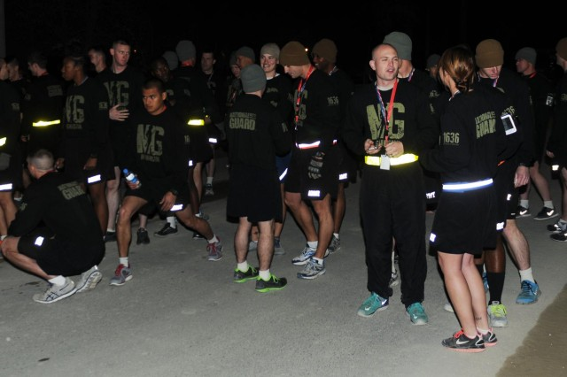 U.S. service members and civilians stretch and prepare for the U.S. National Guard 5k Race and Minuteman Challenge on Bagram Airfield, Afghanistan, Dec. 14, 2013.  The race and challenge concluded a three-day National Guard 377th Birthday celebration hosted by the Ohio National Guard 437th Military Police Battalion and National Guard Affairs-Afghanistan.