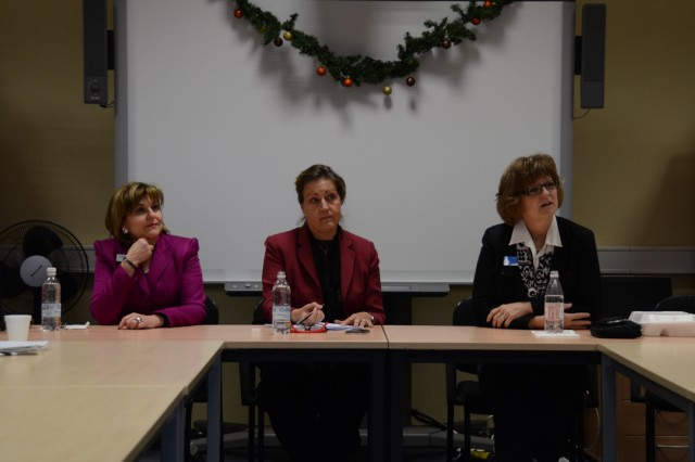 """From left: Judy Brown, Community Bank manager; USAG Bavaria Deputy Garrison Commander Kathy Aydt, and Audrey Binder, director, Family and Morale, Welfare and Recreation, talk with job seekers in the community, sharing secrets of success during the """"Let's Talk Jobs"""" class, Dec. 11."""
