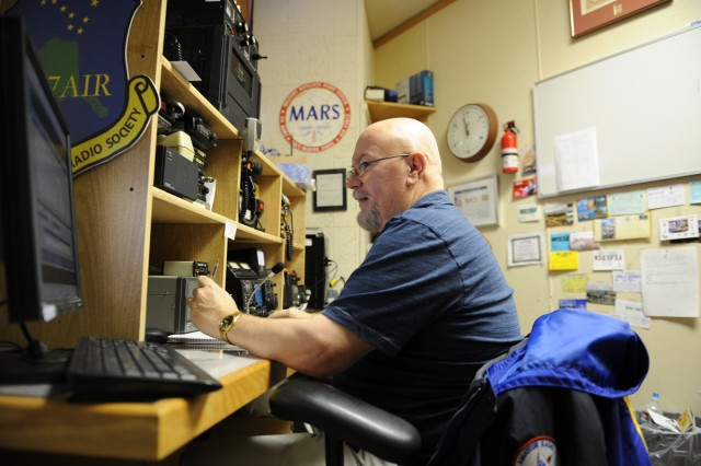 Ron Keech, secretary of the Elmendorf Amateur Radio Society in Alaska, operates a HAM radio in support of the Military Auxiliary Radio System in a Civil Air Patrol building.