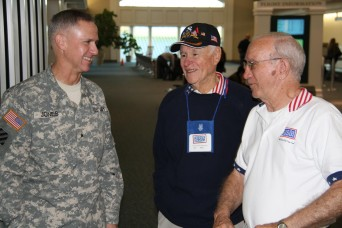 Brig. Gen. Pete Jones, Deputy Commanding General-Support for 3rd Infantry Division, speaks to USO Volunteers before the departure of the 8th Annual Snowball Express Thursday, Dec. 12, 2013 at the Savannah/Hilton Head International Airport. The Snowba...