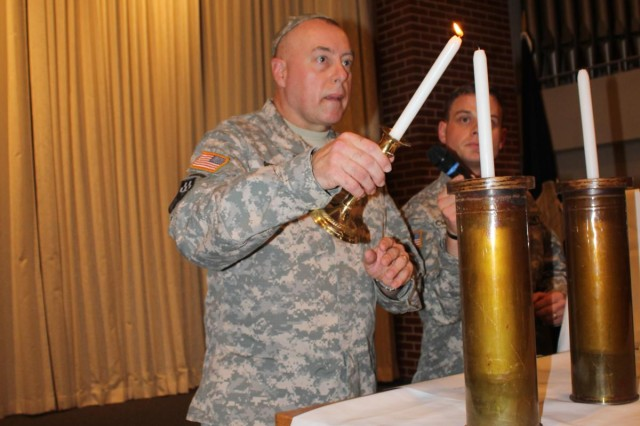 Col. William Pfeffer lights a menorah during the Festival of Lights Hanukkah Ceremony at Soldier Memorial Chapel Dec. 4. Pfeffer was guest speaker for the event.