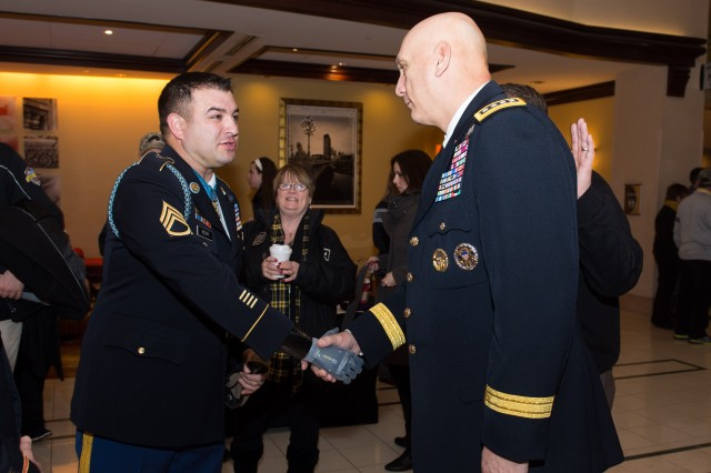 U.S. Army Chief of Staff Gen. Ray Odierno greets Medal of Honor recipient Sgt. First Class Leroy Petry before the 114th Army-Navy football game in Philadelphia, PA, Dec. 14, 2013.  The Army-Navy game is an American college football rivalry between the United States Military Academy and the United States Naval Academy dating back to 1890.  (U.S. Army photo by Staff Sgt. Steve Cortez/ Released)