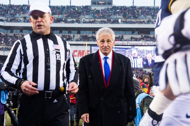 Secretary of Defense Chuck Hagel participates in the ceremonial coin toss of the 114th Army-Navy football game in Philadelphia, PA, Dec. 14, 2013.  The Army-Navy game is an American college football rivalry between the United States Military Academy and the United States Naval Academy dating back to 1890.  (U.S. Army photo by Staff Sgt. Steve Cortez/ Released)