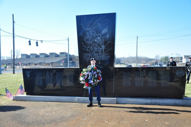 "FORT CAMPBELL, Ky. "" Pfc. Andrew Carignan, a mortarman with Troop B, 1st Squadron, 75th Cavalry Regiment, 2nd Brigade Combat Team, 101st Airborne Division (Air Assault), stands in front of the Gander Memorial at here, during a remembrance ceremony Dec. 12. This marks the 28th anniversary of the tragic event. (U.S. Army photo by Sgt. David L. Cox, 2nd Brigade Combat Team Public Affairs)"