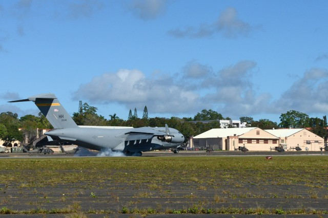 A C-17 Globemaster III aircraft, lands on Wheeler Army Airfield, Hawaii,  Dec. 16. The landing was part of a joint exercise to test joint readiness procedures for the 25th Infantry Division, 5th Battlefield Coordination Detachment and the Air Force's 15th Wing.