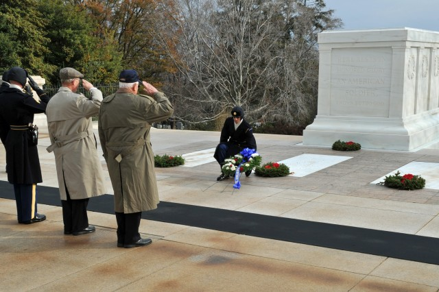 As salutes are rendered by veterans of the Battle of the Bulge, which began 69 years ago, Dec. 16, 1944, in the Ardennes Forrest of Belgium, Luxembourg and The Netherlands, a member of the Tomb of the Unknown guards rests a wreath honoring the more than 19,000 American Soldiers killed there. The battle would effectively end the ability of Germany to pursue the Second World War.