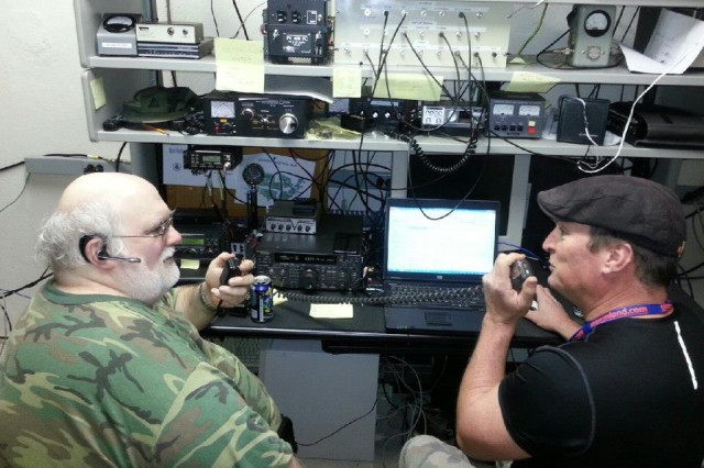 Mark Emanuele (left), Army  Military Auxiliary Radio System Region 2 emergency officer, and Tom Logan operate their Ham radio, relaying emergency information during Hurricane Sandy, in 2012.