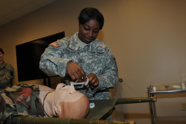 Army Reserve Pfc. Khrysten Cunningham wraps tape around a nasopharyngeal airway during a practical application exercise Nov. 19 at the Regional Training Site-Medical on Fort Gordon, Ga. Cunningham, who is a Waycross, Ga., resident, is a human resources specialist with Headquarters and Headquarters Company, 324th Expeditionary Signal Brigade.