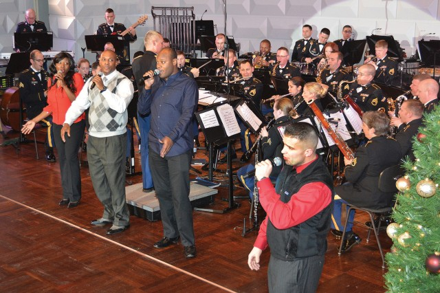 """Members of the U.S. Army Europe Band and Chorus perform """"At Christmas Time"""" during the Christmas in Germany concert in the Wiesbaden Kurhaus Dec. 12."""