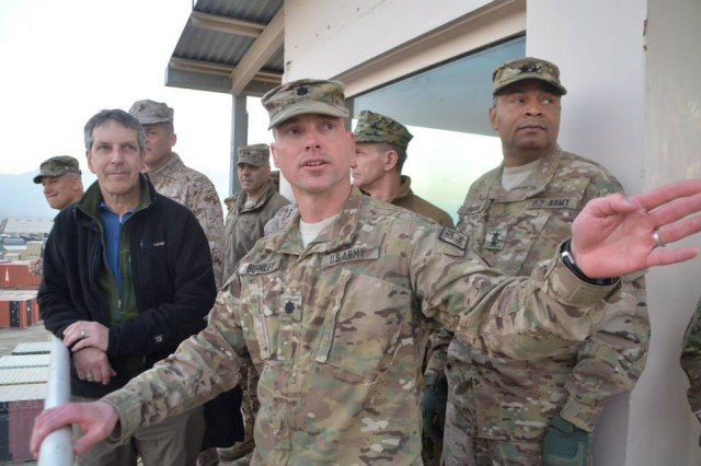 Lt. Col. Todd Burnley, commander, AFSBn-Bagram, 401st Army Field Support Brigade, briefs the Honorable Alan Estevez, assistant secretary of defense for logistics and materiel readiness, and other logistics leaders at the Bagram RPAT tower.